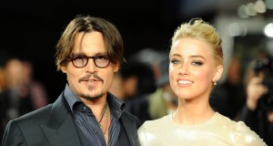 Johnny Depp and Amber Heard pose for photographers as they arrive for the European premiere of 'The Rum Diary' in London