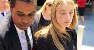 Amber Heard leaving court